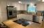 52 SW 95th St, South Beach, OR 97366-9714 - Kitchen