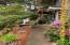 52 SW 95th St, South Beach, OR 97366-9714 - Porch walk way