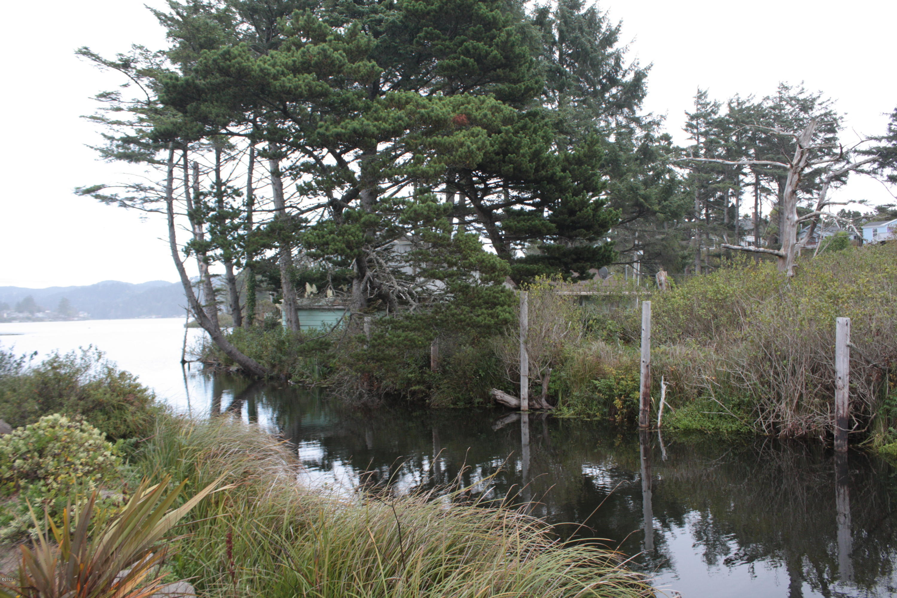 TL 00719 SE 2nd Ct, Lincoln City, OR 97367 - NW from across canal
