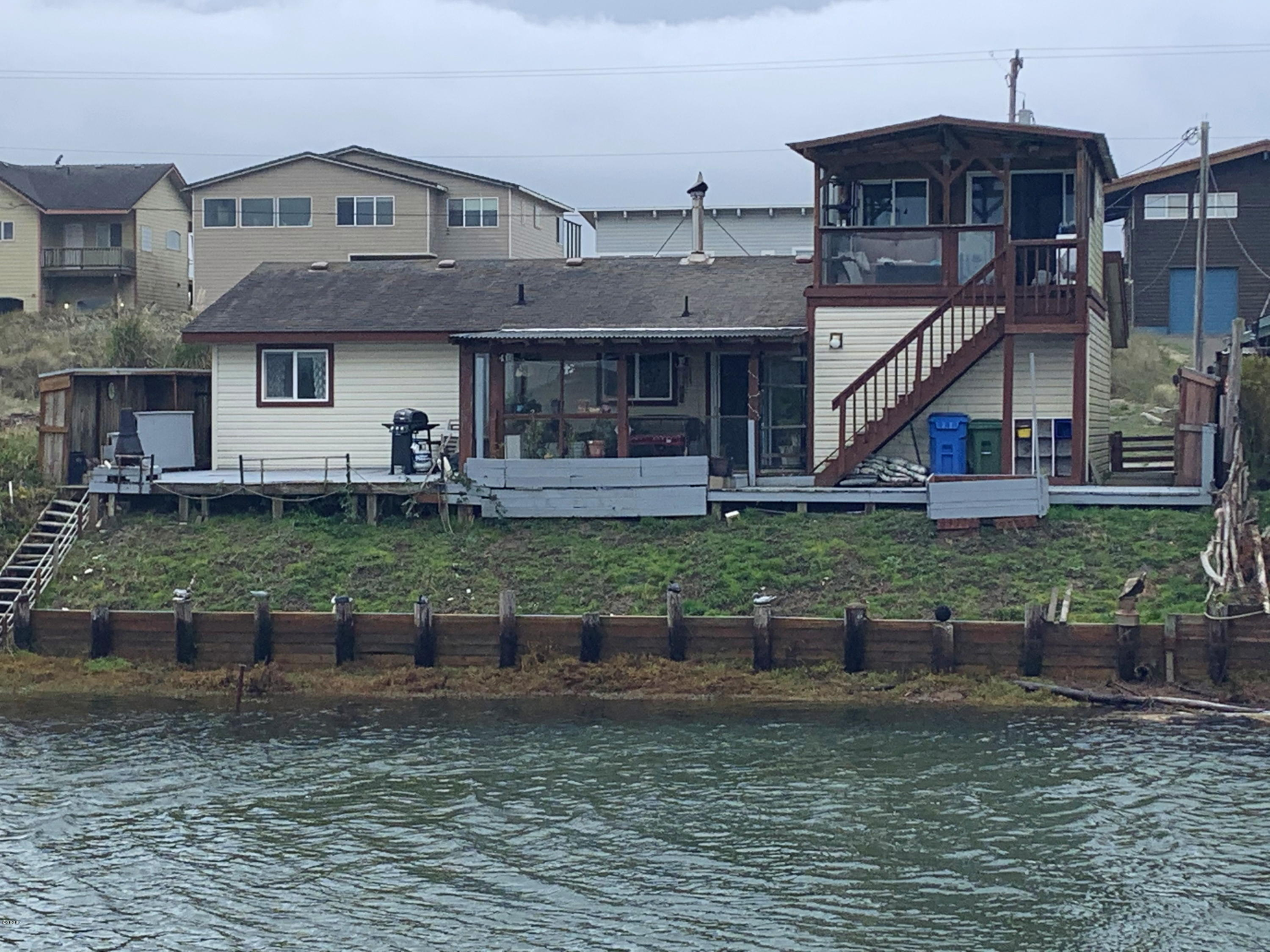 701 NW Oceania Dr, Waldport, OR 97394 - Canal Frontage