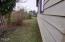138 NE 57th St, Newport, OR 97365 - side yard