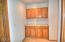 407 SE 127th Pl, South Beach, OR 97366 - Hallway Storage and Linens