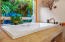Jetted tub with window to private peaceful garden
