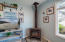 13060 NW Huckleberry Ct, Seal Rock, OR 97376 - Gas fireplace in Living Area