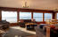 with a wall of windows to enjoy a view of the crashing waves.