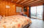 This beautiful knotty pine bedroom features a slider directly out to the private beach stairs.