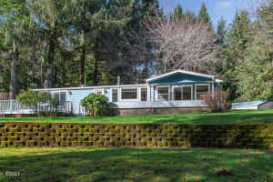 322 Leisure Ln, Siletz, OR 97380 - Front of home.