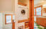 321 SE 35th St, Newport, OR 97365 - Washer in hall
