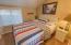 25 Clarke St, Depoe Bay, OR 97341 - Yellow Cabana Bedroom