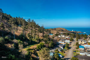 aerial view of lot on left and ocean in distance on right of picture