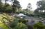 10695 NW Juniper St, Seal Rock, OR 97376 - Front landscape
