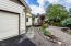 150 NW Lancer St, Lincoln City, OR 97367 - Landscaped Yard and Entry