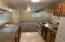 131 N Riverton Ct., Otis, OR 97368 - Kitchen to Living