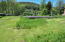 6110 S River Loop, Lincoln City, OR 97367 - view from riverside to road
