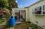 greenhouse with rainbarrel