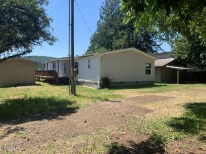 1389 Moonshine Park Rd, Logsden, OR 97357 - Front of property with out buildings