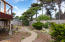 6350 Raymond Ave, Gleneden Beach, OR 97388 - Pathways in fenced back yard