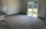 1125 SW Sailfish Loop, Waldport, OR 97394 - Family room with slider