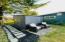 437 NE 10th St, Newport, OR 97365 - Side Yard Sitting Area