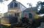 420-440 W 2nd St, Yachats, OR 97498 - Back of home with hot tub