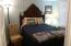 420-440 W 2nd St, Yachats, OR 97498 - Bed ornate headboard