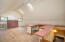 710 N Bay Blvd, Toledo, OR 97391 - Garage with staircase to loft