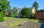 5194 NE 50th St, Neotsu, OR 97364 - Front with shed & path