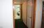 1860 SE Keiski Ln, Waldport, OR 97394 - downstairs hallway to bdrms