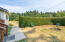 24 N Trout Ln, Otis, OR 97368 - Front yard with fire pit
