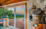 7469 NW Finisterre Ave, Yachats, OR 97498 - Living room slider to deck