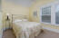 Applegate bedroom on the upper floor, private feel with filtered sunlight thru the shore pines.