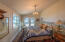 400 SE Gibson Rd, Waldport, OR 97394 - Master bedroom with river view.