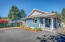 820 NW Estate Dr, Seal Rock, OR 97376 - Front & side view of home