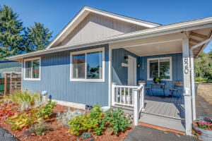 820 NW Estate Dr, Seal Rock, OR 97376 - Front of home with porch