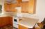 326 SE 118th Street, South Beach, OR 97366 - Kitchen Counter and Stove