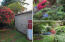 4194 NE C Ave, Neotsu, OR 97364 - Storage shed and blooming garden