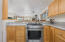 5910 Summerhouse Ln, Pacific City, OR 97135 - Kitchen w/Gas Stove