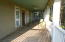 This is porch on bottom level. French doors lead to garage/living areas