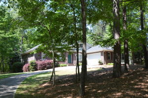 Mostly flat lot, one lot off the lake. Beautifully wooded with a view of the lake.