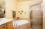 Master bath with big walk-in shower, his and her vanities, huge walk in closet