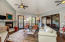 Great room enjoys a fireplace and a charming screened porch adjoins the great room and opens to the deck