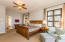 Spacious Master bedroom with sitting area, ensuite bath and doors leading to rear deck