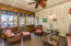 Charming screened porch offers a nice retreat for morning coffee or man-cave