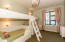 Girls Bunkroom with four built-in bunks and ensuite bath