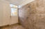 Tiled custom shower leading to walk-out lake level allows for convenient clean up after a fun in the sun