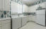 Very large laundry room just off garage service entrance