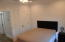another large upstairs bedroom with plenty of storage