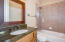Full bath serves 2 of the 3 bedrooms on the lower - the other has an outdoor shower!