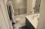 Great main level bathroom with entrance into second bedroom.