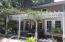 Arbor/seating by sunroom and pool